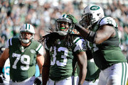 Chris Ivory #33 of the New York Jets is congratulated by his teammate James Carpenter #77 after running the ball for a first quarter touchdown against the Jacksonville Jaguars at MetLife Stadium on November 8, 2015 in East Rutherford, New Jersey.
