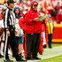 Andy Reid Photos - Head coach Andy Reid of the Kansas City Chiefs calls in a play during the first quarter of the game against the Jacksonville Jaguars at Arrowhead Stadium on October 7, 2018 in Kansas City, Missouri. - Jacksonville Jaguars vs. Kansas City Chiefs