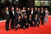 The cast and crew poses with Chinese Director Zhang Yimou on the red carpet ahead of the Ying (Shadow) and 2018 Jaeger-LeCoultre Glory To The Filmaker Award ceremony during the 75th Venice International Film Festival  at Sala Grande on September 6, 2018 in Venice, Italy.