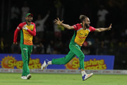 FORT LAUDERDALE, UNITED STATES- AUGUST 18: In this handout image provided by CPL T20, Imran Tahir of Guyana Amazon Warriors celebrates as teammate Shoaib Malik looks onduring the Hero Caribbean Premier League match between Jamaica Tallawahs and Guyana Amazon Warriors at Central Broward Regional Park on August 18, 2018 in Florida, United States.