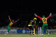 FORT LAUDERDALE, UNITED STATES- AUGUST 18: In this handout image provided by CPL T20, Glenn Phillips of Jamaica Tallwahs is bowled by Imran Tahir of Guyana Amazon Warriors during the Hero Caribbean Premier League match between Jamaica Tallawahs and Guyana Amazon Warriors at Central Broward Regional Park on August 18, 2018 in Florida, United States.
