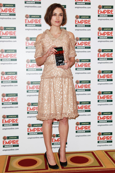 (UK TABLOID NEWSPAPERS OUT) Keira Knightley poses with her Empire Hero Award in the press room at the Jameson Empire Awards 2011 held at Grosvenor House on March 27, 2011 in London, England.