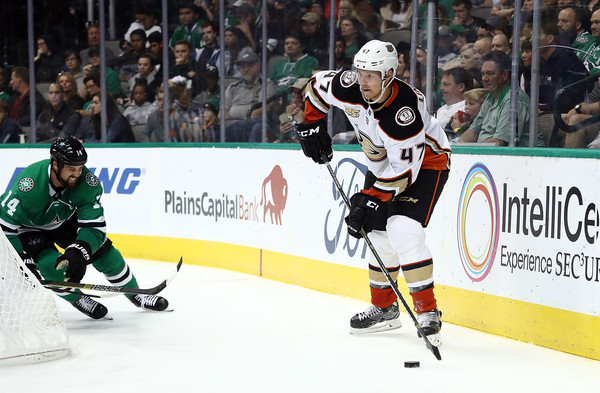 Anaheim Ducks v Dallas Stars [player,college ice hockey,ice hockey,ice hockey position,defenseman,sports,hockey protective equipment,team sport,sports gear,hockey pants,hampus lindholm,jamie benn,puck,dallas,texas,american airlines center,anaheim ducks,dallas stars]