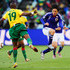 Yasuhito Endo of Japan passes the ball as Stephane Mbia of Cameroon closes him down during the 2010 FIFA World Cup South Africa Group E match between Japan and Cameroon at the Free State Stadium on June 14, 2010 in Mangaung/Bloemfontein, South Africa.