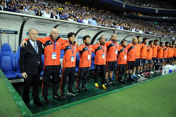 Japan head coach Alberto Zaccheroni (1L) and staffs and players are seen on the bench during the FIFA World Cup Brazil Asian Qualifier match between Japan and Jordan at Saitama Stadium on June 8, 2012 in Saitama, Japan.