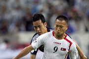Jong Tae-Se of North Korea controls the ball against Maya Yoshida of Japan during the 2014 FIFA World Cup Brazil Asian 3rd Qualifier match between Japan and North Korea at Saitama Stadium on September 2, 2011 in Saitama, Japan.