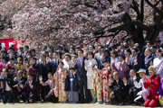 Japan's Prime Minister Shinzo Abe (C-L) and his wife Akie (C-R) pose for photographs with guest attendees during the cherry blossom viewing party at the Shinjuku Gyoen National Garden on April 13, 2019 in Tokyo, Japan.