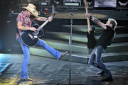 """Recording artist Jason Aldean (L) and bassist Tully Kennedy perform during the launch of Aldean's three-night """"JASON ALDEAN: RIDE ALL NIGHT VEGAS"""" engagement at Park Theater at Park MGM on December 6, 2019 in Las Vegas, Nevada."""