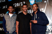 (L-R) Brooklyn Nets players Josh Childress, Carleton Scott and Stephen Dennis attends Jay-Z in concert at the Barclays Center on September 28, 2012 in the Brooklyn borough of New York City.