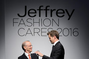Actor Andrew Rannells (R) introduces actor Joel Grey onstage at the Jeffrey Fashion Cares 13th Annual Fashion Fundraiser at the Intrepid Sea-Air-Space Museum on April 4, 2016 in New York City.