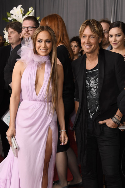 The 59th GRAMMY Awards - Arrivals [fashion,event,dress,fashion design,haute couture,premiere,formal wear,long hair,fashion accessory,fashion model,arrivals,singers,jennifer lopez,keith urban,grammy awards,california,los angeles,staples center,l,the 59th grammy awards]