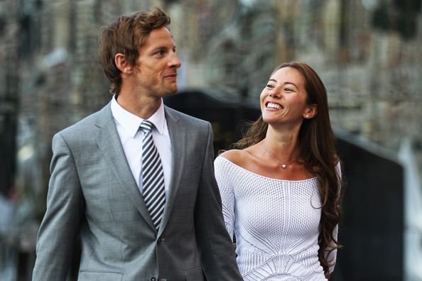 Jenson Button Jenson Button of Great Britain and McLaren and his girlfriend Jessica Michibata leave the paddock for the evening following previews to the Monaco Formula One Grand Prix at the Monte Carlo Circuit on May 27, 2011 in Monte Carlo, Monaco.