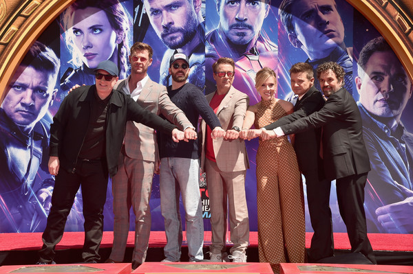 """Marvel Studios' """"Avengers: Endgame"""" Stars Place Handprints In Cement At TCL Chinese Theatre [avengers: endgame stars place handprints in cement,musical,performance,event,stage,heater,performing arts,musical theatre,movie,premiere,photography,kevin feige,president,chris hemsworth,chris evans,scarlett johansson,robert downey jr.,tcl chinese theatre,marvel studios,hand and footprint ceremony]"""
