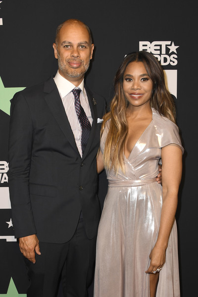 2019 BET Awards - Press Room [suit,formal wear,event,tuxedo,premiere,dress,white-collar worker,little black dress,smile,carpet,president,ceo,jesse collins,regina hall,bet awards,l-r,room,press room,california,jesse collins entertainment]