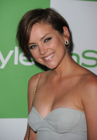 Jessica Stroup wearing a pixie haircut and strapless gown