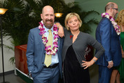 """Greg Garcia and Martha Plimton attend the Broadway premiere of """"Escape to Margaritaville"""" the new musical featuring songs by Jimmy Buffett at the Marquis Theatre on March 15, 2018 in New York City."""