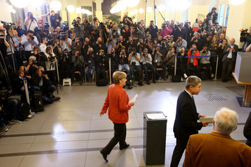 Joachim Sauer Angela Merkel Casts Her Ballot in the Federal Elections