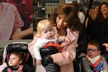 Joan Collins Shooting Star Chase's Boutique Charity Shop Opening