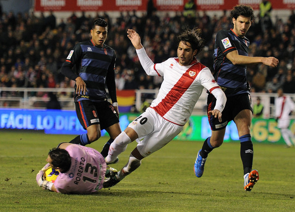 Rayo Vallecano de Madrid v Granada CF - La Liga [player,sports,sports equipment,football player,team sport,ball game,sport venue,soccer player,tournament,games,roberto fernandez,joaquin larrivey,v,ball,stadium,granada cf,rayo vallecano de madrid,la liga,l,match]