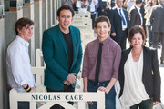 (L-R) US film director David Gordon Green, US actors Nicolas Cage, Tye Sheridan and US producer Lisa Muskat pose at a photocall for the movie 'Joe' on the Promenade des Planches during the 39th Deauville American film festival on September 2, 2013 in Deauville, France.