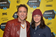 Actor Nicholas Cage (L) and actor Tye Sheridan pose for photos in the green room for the premiere of 'Joe' during the 2014 SXSW Music, Film + Interactive Festival at Paramount Theatre on March 9, 2014 in Austin, Texas.