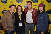 (L-R) Director David Gordon Green, Janet Pierson, SXSW Film Festival Director, actor Nicholas Cage and actor Tye Sheridan pose for photos in the green room for the premiere of 'Joe' during the 2014 SXSW Music, Film + Interactive Festival at Paramount Theatre on March 9, 2014 in Austin, Texas.