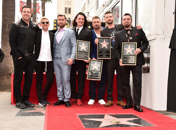 NSYNC Honored With Star On The Hollywood Walk Of Fame [nsync honored with star on the hollywood walk of fame,red,team,event,technology,flooring,carpet,recreation,award,ceremony,carson daly,joey fatone,justin timberlake,jc chasez,ellen degeneres,lance bass,chris kirkpatrick,hollywood walk of fame,ceremony]