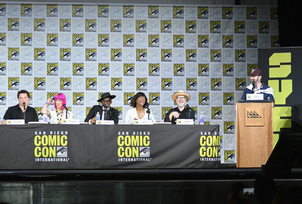 Comic-Con International 2017 - SYFY Hosts The Great Debate [comic-con international 2017 - syfy hosts the great debate,yellow,stage equipment,event,font,news conference,fiction,advertising,john barrowman,adam savage,charlie jane anders,john hodgman,actors,aisha tyler,l-r,san diego convention center,syfy]