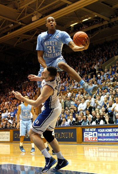 John Henson John Henson #31 of the North Carolina Tar Heels jumps over Miles Plumlee #21 of the Duke Blue Devils as he drives to the basket during their game at Cameron Indoor Stadium on March 3, 2012 in Durham, North Carolina.