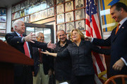 Sen. John McCain (R-AZ) (L) turns to greet Rep. Ileana Ros-Lehtinen (R-FL) (2R) and Rep. Mario Diaz-Balart (R-FL) (R) during a campaign visit to support Republican presidential candidate, former Massachusetts Gov. Mitt Romney at the Bay of Pigs Museum and Library of the 2506 Assault Brigade in the Little Havana neighborhood on October 25, 2012 in Miami, Florida. McCain took the time to rally people behind Romney and to encourage them to go out and vote.