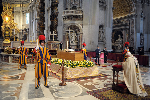 Pope Benedict XVI prays in front of the coffin of John Paul II at St. Peter's Basilica at the end of John Paul II Beatification Ceremony on May 1, 2011 in Vatican City, Vatican. The ceremony marking the beatification and the last stages of the process to elevate Pope John Paul II to sainthood was led by his successor Pope Benedict XI and attended by tens of thousands of pilgrims alongside heads of state and dignitaries.