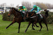 Don't Push It ridden by A.P McCoy (6) clears the last fence and races for the finish line alongside Black Apalachi ridden by Denis O'Regan (4) on their way to victory in The John Smith's Grand National Steeple Chase at Aintree Racecourse on April 10, 2010 in Liverpool, England.