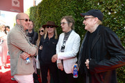 (L-R) Fashion designer John Varvatos, recording artists Daxx Nielsen, Robin Zander, Tom Petersson and Rick Nielsen of music group Cheap Trick attend the John Varvatos 13th Annual Stuart House benefit presented by Chrysler with Kids' Tent by Hasbro Studios at John Varvatos Boutique on April 17, 2016 in West Hollywood, California.