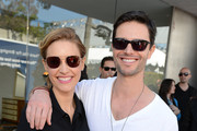Actors KaDee Strickland (L) and Jason Behr wearing John Varvatos Eyewear at the 10th Annual Stuart House Benefit presented by Chrysler at John Varvatos Los Angeles on March 10, 2013 in Los Angeles, California.