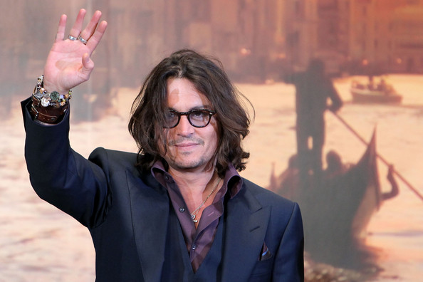 Johnny Depp Actor Johnny Depp waves as he attends the Japan Premiere of 'The Tourist' at Roppongi Hills Arena on March 3, 2011 in Tokyo, Japan. The film will open in Japan on March 5.
