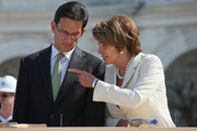 """House Majority Leader Eric Cantor (R-VA) (L) and House Minority Leader Nancy Pelosi (D-CA) (R) talk during the """"First Nail"""" ceremony, signifying the start of construction of the 2013 Inaugural Platform on the West Front of the U.S. Captiol September 20, 2012 in Washington, DC. The winner of the November 6 presidential election will be sworn in on the platform on January 21, 2013."""