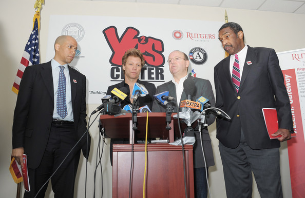 White House Council For Community Solutions Youth Listening Session With Jon Bon Jovi [event,news conference,stage equipment,technology,public speaking,award,orator,employment,businessperson,ceremony,michael kempner,cory booker,jon bon jovi,bill strickland,president,press,l-r,newark,white house council for community solutions youth listening session with jon bon jovi,manchester craftmans guild]