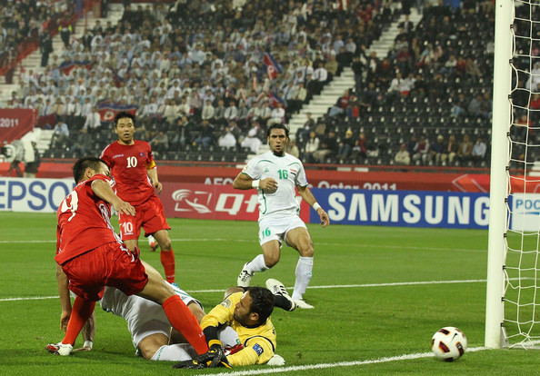 AFC Asian Cup - Iraq v DPA Korea [player,sports,sports equipment,sport venue,team sport,ball game,football player,soccer player,tournament,soccer,jong tae se,mohammed kassid,basem abbas,goal,shot,iraq,dpr korea,dpa korea,afc asian cup group d,afc asian cup]