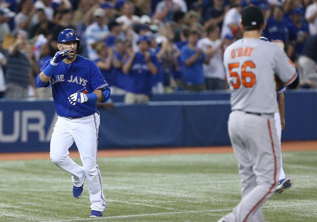 Jose Bautista #19 of the Toronto Blue Jays has words for Darren O'Day #56 of the Baltimore Orioles after hitting a 2-run home run in the eighth inning during MLB game action against on June 22, 2013 at Rogers Centre in Toronto, Ontario, Canada.