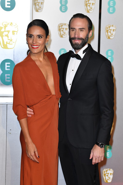 EE British Academy Film Awards - Red Carpet Arrivals [suit,formal wear,carpet,red carpet,fashion,hairstyle,dress,tuxedo,event,award,red carpet arrivals,maria dolores dieguez,joseph fiennes,r,ee,england,london,royal albert hall,british academy film awards]