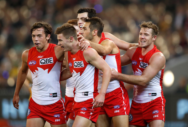 AFL Rd 8 - Hawthorn Vs. Sydney [sports,team sport,player,ball game,tournament,team,championship,muscle,recreation,international rules football,ben ronke,teammates,goal,left,sydney,melbourne cricket ground,rd 8 - hawthorn vs.,sydney swans,afl,match]