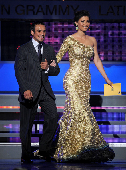 The 12th Annual Latin GRAMMY Awards - Show [dress,clothing,fashion model,fashion,formal wear,event,gown,shoulder,fashion design,haute couture,chiquinquira delgado,boxer juan manuel marquez,award,las vegas,nevada,mandalay bay events center,latin grammy awards,show]