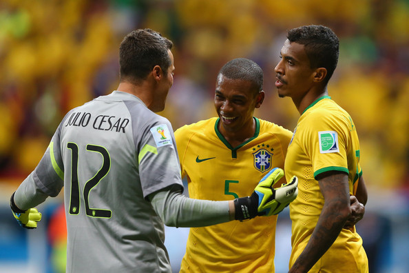 Cameroon v Brazil: Group A - 2014 FIFA World Cup Brazil [player,football player,product,yellow,team sport,team,soccer player,sports equipment,sports,sport venue,luiz gustavo,fernandinho,julio cesar,l-r,brazil,cameroon,estadio nacional,brasilia,brazil: group a - 2014 fifa world cup,match]