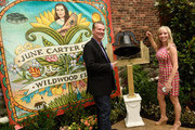 Bill Miller and Shannon Miller (museum founders) attend the June Carter Cash Birthday Celebration At The Opening Of The June Carter Cash Wildwood Flower Garden at The Johnny Cash Museum on June 23, 2015 in Nashville, Tennessee.