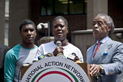 Trayvon Martin's mother Sybrina Fulton speaks at a podium as Trayvon Martin's brother Jahvaris Fulton (L) and Rev. Al Sharpton attend a rally honoring Trayvon Martin organized by the National Action Network outside One Police Plaza in Manhattan on July 20, 2013 in New York City.  Demonstrators have gathered in various cities across the country to protest the acquittal of neighborhood watchman George Zimmerman and press for his federal prosecution in the shooting death of teenager Trayvon Martin.