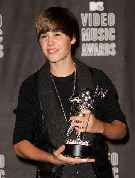 Justin Bieber Singer Justin Bieber poses in the press room with his award