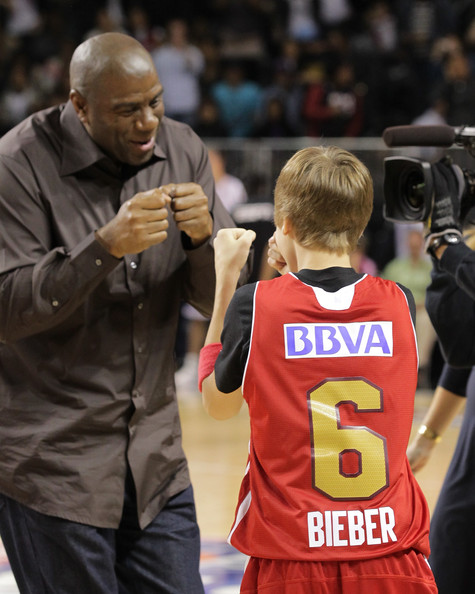 Justin Bieber Justin Bieber (R) and Magic Johnson play at the 2011 BBVA NBA All-Star Celebrity Game at the Los Angeles Convention Center on February 18, 2011 in Los Angeles, California.