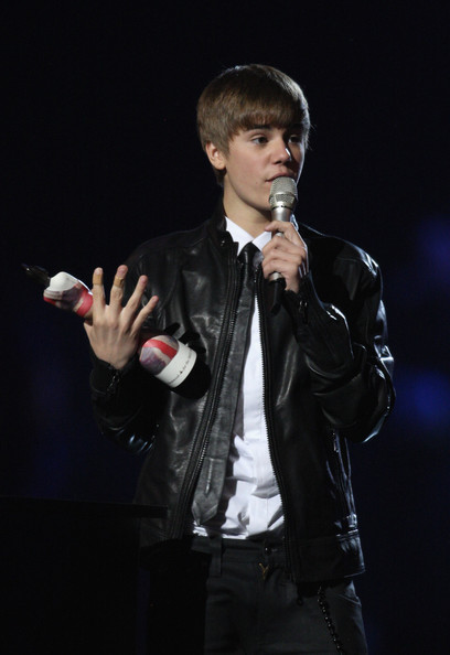 Justin Bieber Justin Bieber accept the International Breakthrough Act Award onstage at The Brit Awards 2011 held at The O2 Arena on February 15, 2011 in London, England.