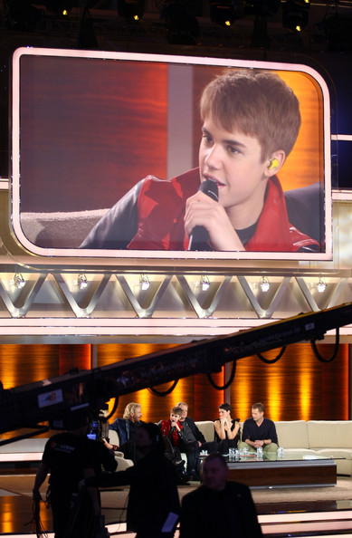 Justin Bieber Singer Justin Bieber is seen on a giant screen during the 'Wetten Dass ... ?' TV show at Augsburg fair ground on March 19, 2011 in Augsburg, Germany.