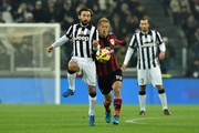 Andrea Pirlo (L) of Juventus FC clashes with Keisuke Honda of AC Milan during the Serie A match between Juventus FC and AC Milan at Juventus Arena on February 7, 2015 in Turin, Italy.